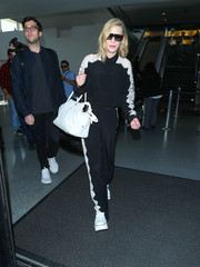 Cate Blanchett arrived on a flight at LAX wearing a black button-down with white lace trim.