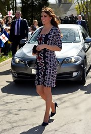 Kate Middleton swapped her typical solid-color frock for a  flattering printed dress while visiting a London school.