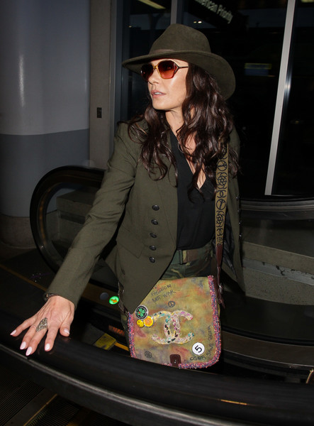 Catherine Zeta-Jones was tough-chic in a green military jacket while catching a flight.