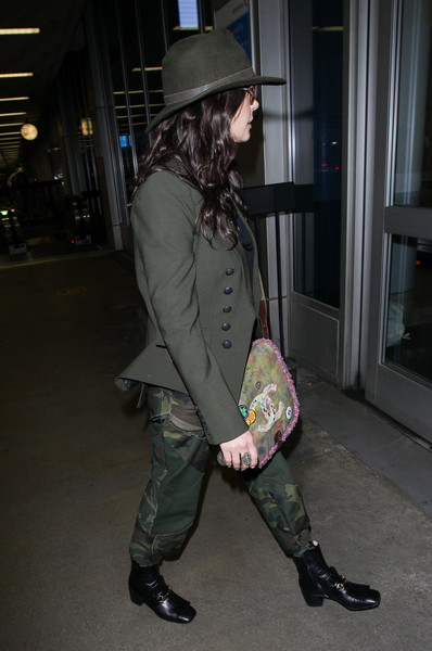 Catherine Zeta-Jones completed her ensemble with a pair of black ankle boots by Gucci.