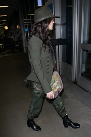 Catherine Zeta-Jones teamed camo pants with a military jacket for her edgy airport look.