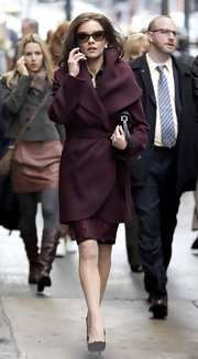 Catherine Zeta Jones looked polished on set in a wine shawl collar coat.