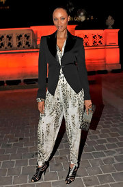 Tyra made a fun apparel combination with this sharp tuxedo blazer and print jumpsuit.