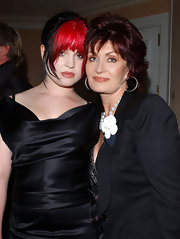 Sharon Osbourne styled her plain black blazer with a white flower brooch while out with her daughter Kelly at the Beverly Hills Hotel.