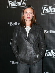 Italia Ricci kept warm in edgy style with a black leather biker jacket while attending the 'Fallout 4' launch party.