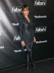 Halle Berry looked as hot as ever in a black high-low cowl-neck top teamed with sheer-panel leggings and over-the-knee boots at the 'Fallout 4' launch party.