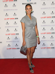 Eva la Rue attended the LA Art Show opening carrying a chic silver satin purse by Dior.