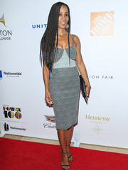 Shaun Robinson showed off her slim physique at the Ebony Power 100 70th anniversary gala in a fitted cutout dress in two shades of gray.