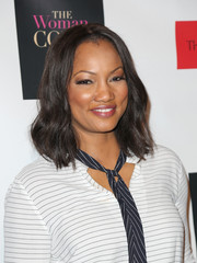 Garcelle Beauvais opted for a casual yet cute wavy hairstyle when she attended the 'Woman Code' event.