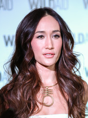 Maggie Q adorned her bare neckline with a gold statement necklace by Tory Burch.