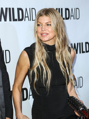 Fergie wore her long wavy tresses loose when she attended WildAid 2015.