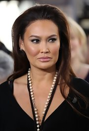 Tia Carrere wore a minimally styled long straight cut when she was interviewed on 'Extra.'