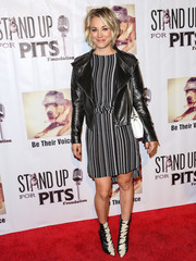 Kaley Cuoco paired her dress with a black leather jacket for a touch of edge.