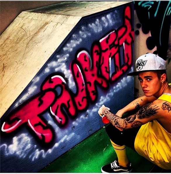 Justin Bieber was sporty and hip hop at the same time wearing this L.A. Kings cap, tank top, shorts, and sneakers combo.
