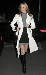 Bo Derek looked perfectly put together in a chic white coat, gray and black mini dress, and knee-high boots.