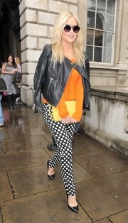 A yellow clutch adds a ray of sunshine to Laura Whitmore's London Fashion Week getup.