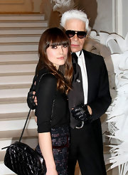 "With Karl, Keira is amazing in head to toe Chanel with her classic ""Quilted Zip Top"" handbag."