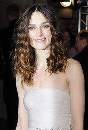 Keira Knightley showed off long curls at the BAFTA after party. A soft ombre color combination completed her alluring look.