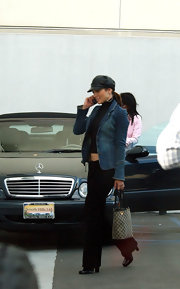 J-lo wore a leather captain's cap paired with a cropped jean jacket.
