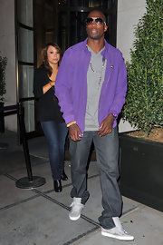 Chad Ochocinco donned a bright violet track jacket with dark denim jeans. He paired the look with his favorite silver aviators.