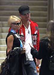 Chad wears a casual military cap when out with his fiance.