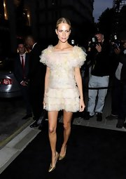 Poppy Delevingne opted for maximum ruffles with this watercolor ruffled mini.