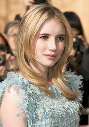Emma Roberts attended the Chanel Fall 2011 fashion show with a center part straight cut.