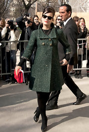 Lily opted for a forest green tweed coat for the Chanel fashion show in Paris.