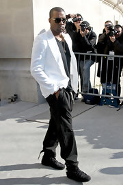 Kanye looked street chic in a crisp white blazer and black slacks at the Chanel fashion show in Paris.