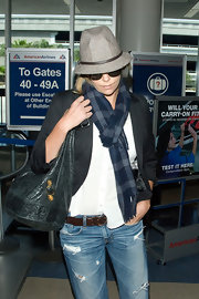 Charlize's large distressed navy hobo bag is perfect for international travel.