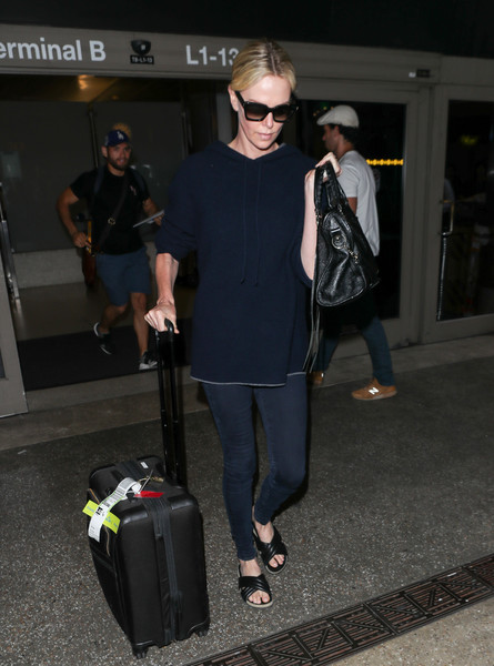 Charlize Theron Slide Sandals Are The Summer Footwear Trend We Can't Get Enough Of []