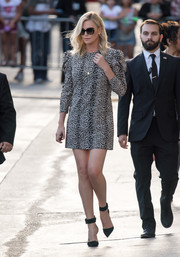 Charlize Theron put her endless legs on display in an animal-print mini dress by Saint Laurent while headed to 'Kimmel.'