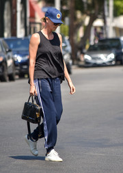 Charlize Theron showed off a chic black leather tote by Prada.