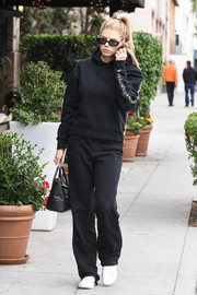 Charlotte McKinney matched her top with a pair of black Cotton Citizen sweatpants.