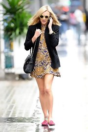 Fearne keeps her dress dry on a cool rainy day thanks to this chic black blazer.