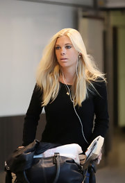 Chelsy Davy wore her platinum blond locks slightly wavy and center-parted.