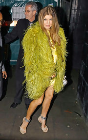 Fergie wears a fabulously enormous chartreuse feathered coat.