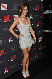 Cheryl Cole hit a party donning a silver cocktail dress and a messy updo.