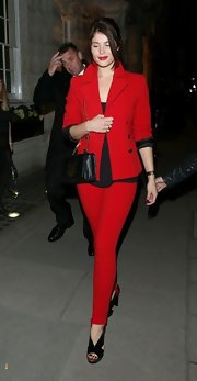Gemma was red hot in this vibrant blazer and matching skinny jeans for a charity auction in London.