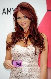 Amy Childs completed her look for a Samsung promotional event with frosty peachy-pink lipstick.