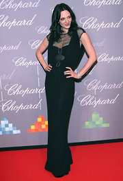 Asia Argento looked elegant wearing a black Chanel gown at the Chopard Trophy at Cannes.