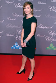 Isabelle Huppert's stunning cuff bracelet stood out against her simple green sheath at the Chopard Trophy.
