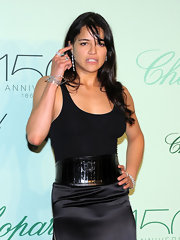 Michelle Rodriguez dressed up her tank and skirt combo with a chic oversized belt when she attended the Chopard Trophy party.