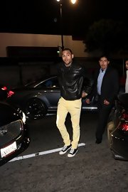 Chris Brown kept comfy while partying in a pair of classic Converse sneakers.