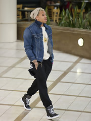 Chris Brown hid his blonde hair in an oversized nude beanie as he walked through LAX.