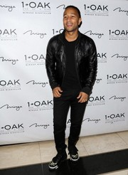 John Legend was edgy in black slacks and a leather jacket during a 1Oak event.