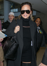 Chrissy Teigen topped off her look with a pair of modernized aviators by Fendi.