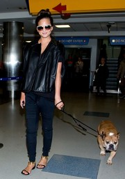 Chrissy Teigen chose flat black sandals with embellished gold ankle straps for a comfy-chic finish.
