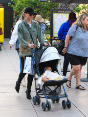 Chrissy Teigen did mommy duty looking edgy-chic in a military jacket by Ottotredici.