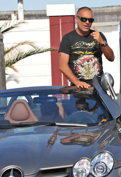 Christian sports his own design in this Ed Hardy t-shirt.
